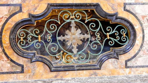 The iron work partially concealing the inhabitant of the alter at the Oratorio di San Giovanni. Photo Credit: Caterina Novelliere Sept 2016